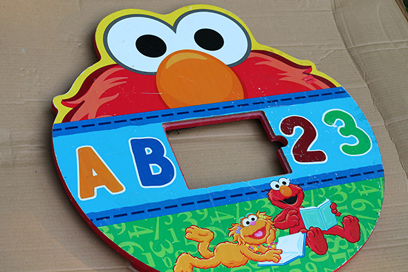 Elmo table painted and turned into a cookie monster toss for Sesame Street birthday party