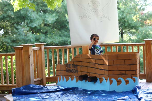 pirate party with pirate ship made out of a cardboard box