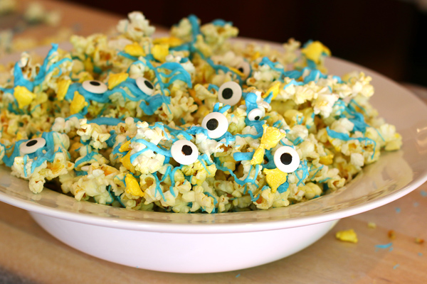 As a special treat, I also made Minion Munch, which is simply white candy coating that I dyed blue spread over popcorn and tossed with Minion candies and candy eyes. (One note, do NOT put this outside on a hot day because it will melt. Ask me how I know?) I bought yellow and blue plates and Minion napkins.