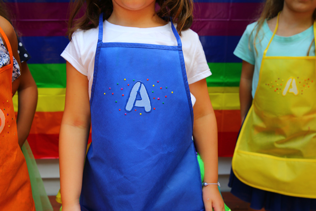 Rainbow art party aprons, art supplies and how to set it up